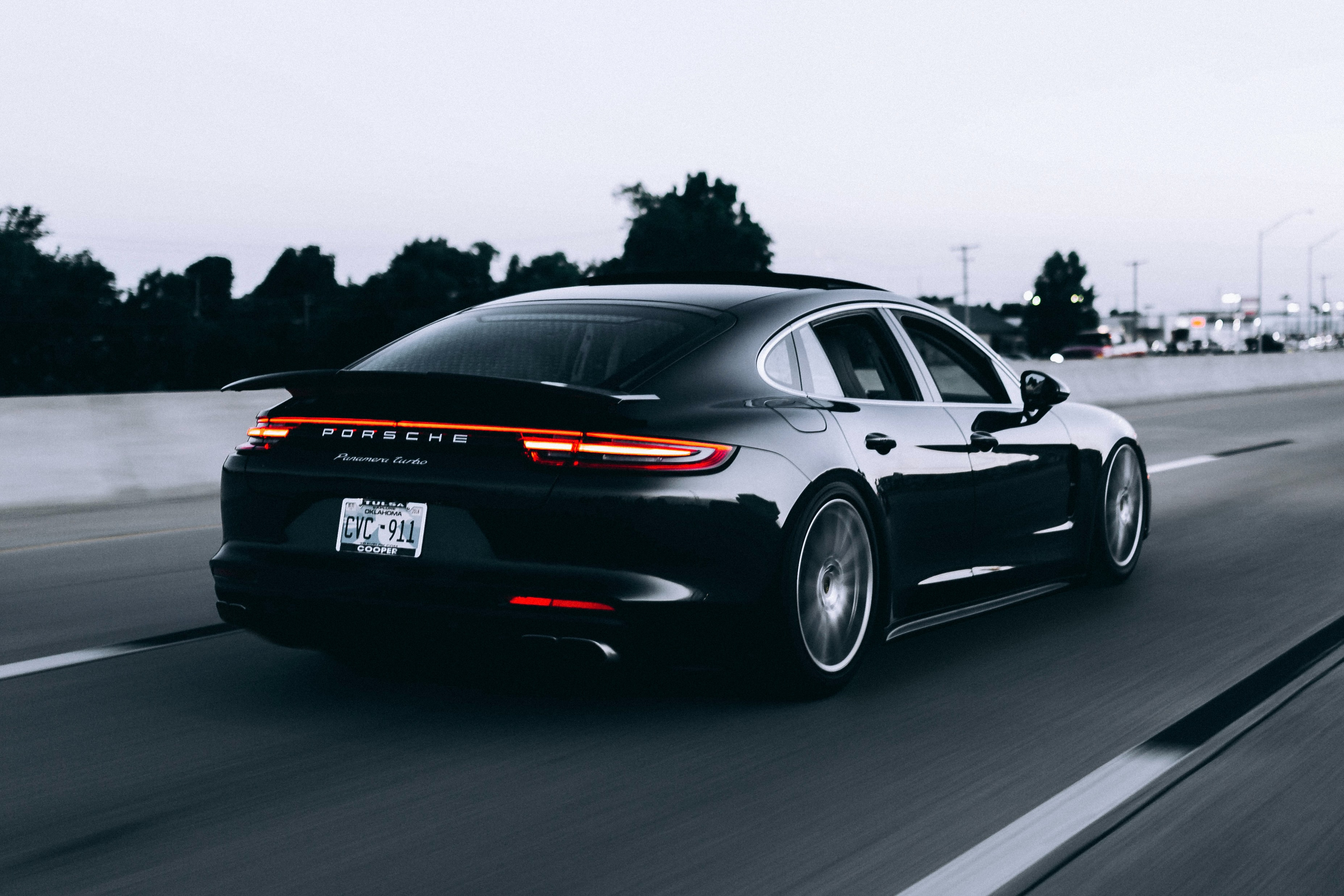 Black Porsche Panamena Turbo On The Road